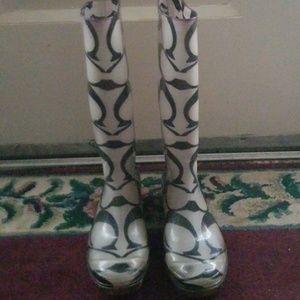 Coach cloudy clear rain boots.